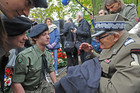 Brig. Stefan Baluk, 99, right, the last living WWII airborne fighter speaks to Polish scouts during the unveiling ceremony of the monument in Warsaw, Poland. Photo / AP
