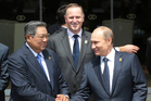 Russian President Vladimir Putin, right, is welcomed by his Indonesian counterpart Susilo Bambang Yudhoyono and Prime Minister John Key. Photo / AP