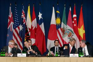 John Key and John Kerry helped lead the TPPA meeting. Photo / AP