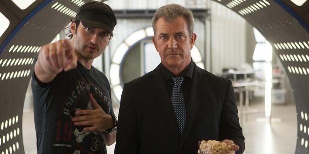 Director Robert Rodriguez, left, with actor Mel Gibson on the set of 'Machete Kills'. Photo / AP
