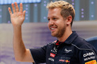 Red Bull driver Sebastian Vettel smiles and waves at his fans during an event at the Nissan Motor Co.'s global headquarters in Yokohama, Japan. Photo / AP