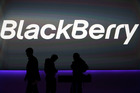BlackBerry's employees prepare the launch event for the company's new smartphones in London early this year.
