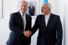 British Foreign Minister William Hague, left, shakes hands with Iran's Foreign Minister Mohammad Javad Zarif. Photo / AFP