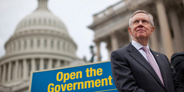 Senate Majority Leader Harry Reid stands on the Senate steps on Capitol Hill in Washington during a news conference on the ongoing budget battle. Photo / AP