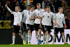 Germany's Andre Schuerrle, left, celebrates with his teammates after scoring their side's second goal during the 2014 World Cup Group C qualifying soccer match between Germany and Ireland. Photo / AP