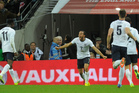 England's Andros Townsend, centre, turns towards his teammate Danny Welbeck as he celebrates after scoring a goal during the World Cup Group H qualification soccer match. Photo / AP