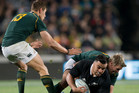 All Blacks flanker Liam Messam busts through tough defence.