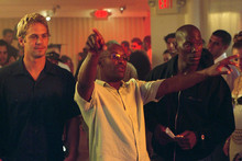 Paul Walker and Tyrese Gibson with '2 Fast 2 Furious' director John Singleton (centre).