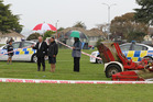 A blessing is given at Kirkpatrick Park, Hastings, where a four year-old boy died after playing near a Hastings District Council tractor and lawn-mower. Photo / Duncan Brown