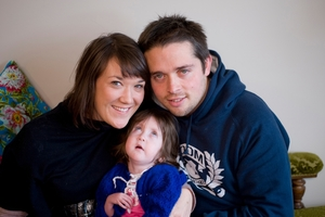 Parents Rachel and Sam Callander with Evie, who had chromosomal and genetic disorders and died aged 2.