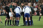 All Black manager Darren Shand, centre, talks to referee Nigel Owens over the team sheet error with replacement Dane Coles. Photo / Getty Images