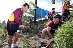 Northern Knights players (left) Brad Wilson and Daniel Flynn (captain) work on land outside the Okara Educare playground. Photo / John Stone