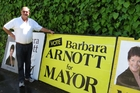 David Arnott, husband of retiring Napier Mayor Barbara Arnott, with signs he has placed during her election campaigns from 1995-2010. Photo / Warren Buckland