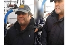 In secret footage filmed during Russian authorities' inspection of the Greenpeace ship Arctic Sunrise, Captain Peter Willcox, still handcuffed to an official, describes the moment when armed agents searched the vessel and seized laptops and memory cards.