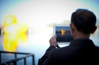 The computer and smartphone screen of the future will move to another dimension from touchscreens and allow users to feel videos and images. Photo / AP