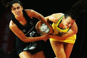 Silver Fern Maria Tutaia wrestles for the ball with Diamond Bianca Chatfield. Photo / Getty Images
