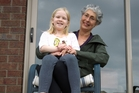 Denise Pearson and granddaughter Emily Grethe, 8, look over the artificial grass in the yard. Picture / Richard Robinson