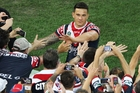Sonny Bill Williams shares the joy with Sydney Roosters fans after the NRL grand final. Photo / Getty Images