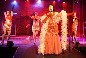 "SEQUINS AND SHIMMIES: Bex Johnson (centre), as Reno, Mistress of Ceremonies, flanked by her ""gorgeous girls"", sings The Lady is a Tramp. PHOTO/SUPPLIED"