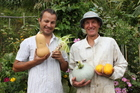 James (left) and Chris (right) from All Good Organics holding their bumper crop.  Photo / Paul Thompson