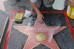 John Lennon's star on the Walk of Fame is scrubbed clean. Photo / AP