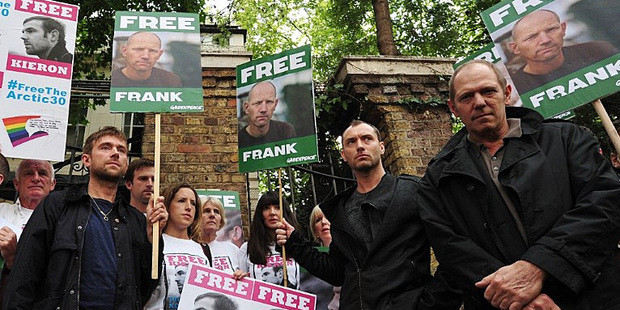 Damon Albarn, left,  Jude Law and Paul Simonon take part in a protest against the detention of Greenpeace activists in Russia. Photo / AP