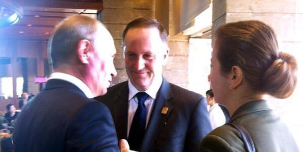 John Key posted this photo to his Twitter account, saying 'It was good to catch up with Russian President Vladimir Putin in Bali today.'
