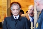 The longtime secretary of imprisoned financier Bernard Madoff and four other subordinates are on trial as the government, for the first time, shows a jury what it has collected in its five-year probe of one of history's biggest frauds.