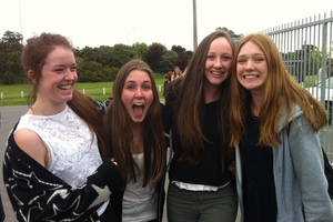 Stacey Collier, 16, Tilly Walter, 17, Magdalena Regnault, 17, and Alex Wright, 17, arrived seven hours early for tonight's One Direction gig in Christchurch. Photo / Kurt Bayer