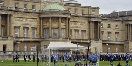 Polytechnic FC (blue) play Civil Service FC in the grounds of Buckingham Palace. Photo / AFP