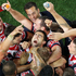 Anthony Minichiello of the Roosters celebrates with team mates at full-time. Photo / Getty Images