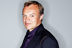 "Chat show host Graham Norton says he enjoys being ""the dull one in the chair""."