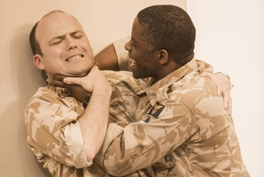 Iago (Rory Kinnear) faces the wrath of Othello (Adrian Lester).