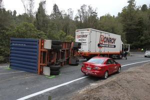 Crash. A truck heading towards Tauranga lost control of his trailor in the gorge on Pyes Pa Rd Photo by John Borren