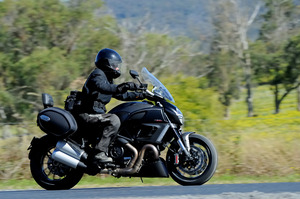 The Ducati Diavel Strada sports the overtly muscular looks of an upper-class nightclub bouncer.