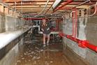 WPBH foreman Dean Rankin wades along a basement corridor. Photo / BEVAN CONLEY