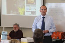 Wanganui District Council chief executive Kevin Ross (right) addresses the Civil Defence emergency meeting yesterday. To his left is CD manager Max Benseman.