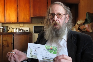 SCAMMED: Mike Howard with the scratch-and-win ticket claiming he had won US$170,000. PHOTO / PETER DE GRAAF