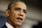 President Barack Obama announces this week that America is open again ... but disaster was only narrowly avoided. Photo / AP