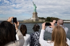 The Statue of Liberty is one monument reopening after some states put up their own funds to pay federal employees and get them back to work. Photo / AP