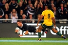 Aaron Cruden scores a try against the Wallabies last night. Photo / Getty Images