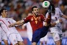 Alvaro Negredo (centre) scored against Georgia to help Spain qualify for Brazil. Photo / AP