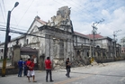 The Basilica of the Holy Child in Cebu, the Philippines' oldest church, lost its bell tower. Photo / AP