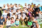 OutKast Sports players and supporters celebrate back to back Hawke's Bay premier rugby league grand final wins after Saturday's 40-10 victory against Napier Panthers in Hastings. Photo / Paul Taylor
