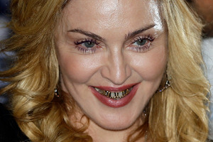 Madonna has been banned from an American movie chain over reports she texted during a screening. Photo / AP