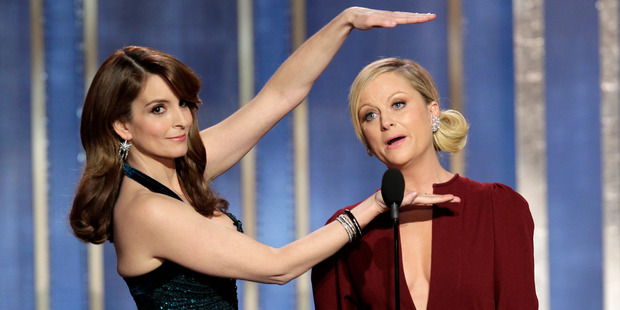 Tina Fey and Amy Poehler will host the Golden Globe Awards for the next two years. Photo / AP