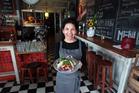 Staff member Sarah with a fish taco. Photo / Doug Sherring