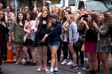 One Direction fans stand outside the Langham Hotel hoping to catch a glimpse of the band. Photo / Dean Purcell