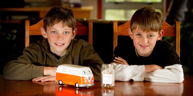 11-year-old twins Josh (left) and Cameron Stokes have a week in which to decide how to spend their pocket money. Photo / Christine Cornege