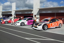 The three M3 racing cars with Paul Manuell in front of Richard Moore and his car and Greg Murphy's further back.